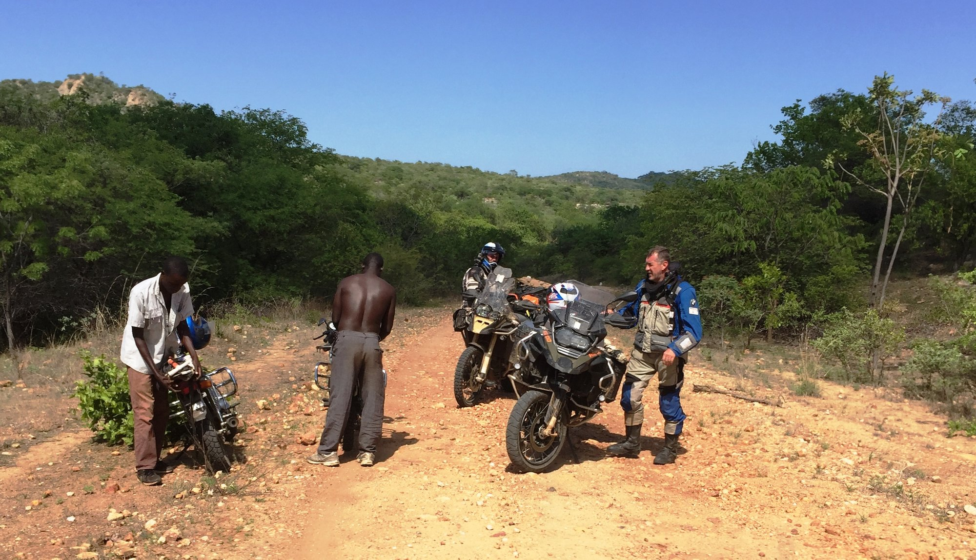 Helping another biker.JPG