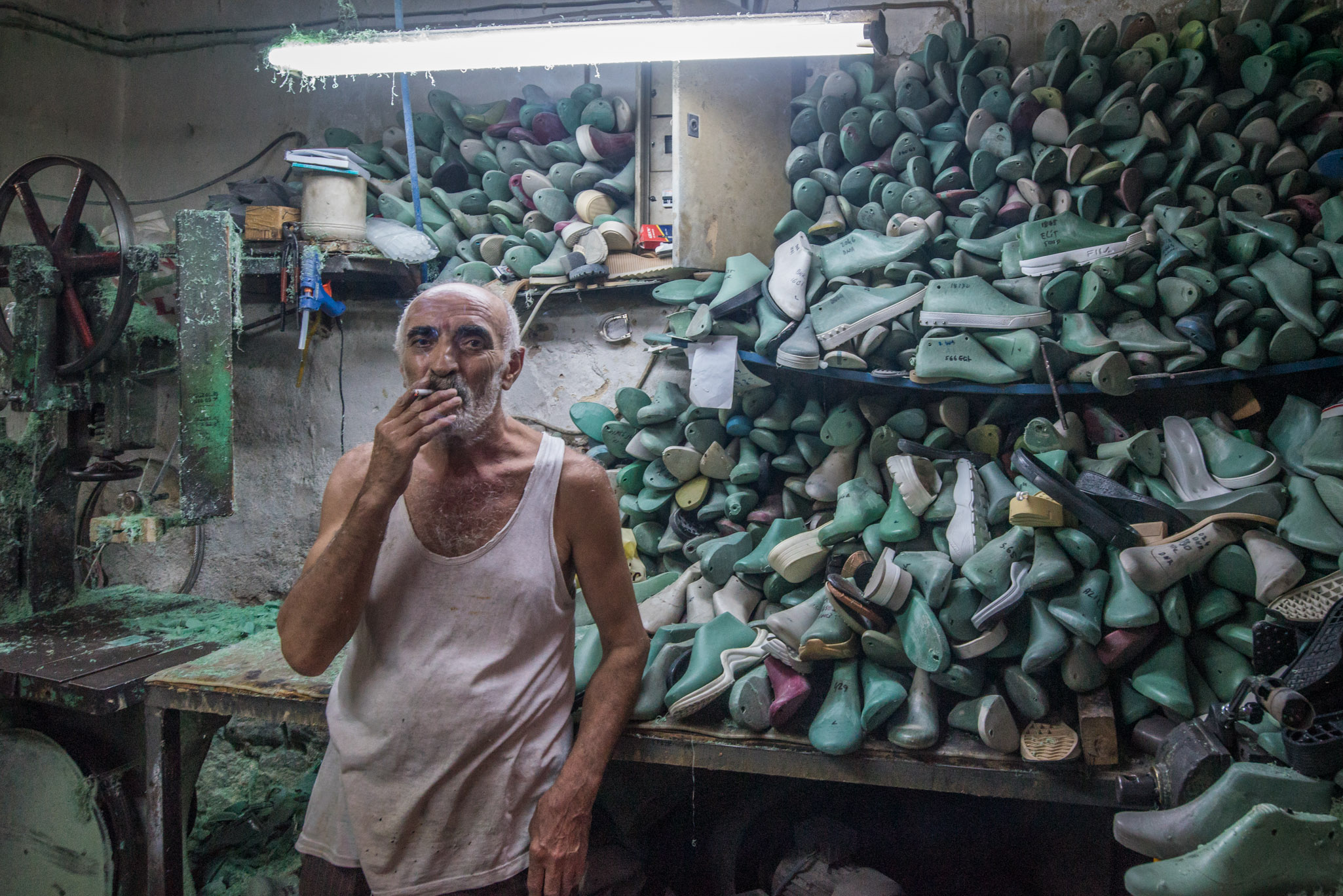 Clinton Logan - An Armenian man takes a quick cigarette break in the subterranean sweatshops of Istanbul.